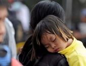 http://xahoi.com.vn/em-be-ngu-tren-lung-me-cho-mua-ve-xem-olympic-vn-204996.html