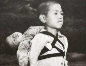 https://xahoi.com.vn/buc-anh-anh-cong-em-da-chet-tren-lung-voi-guong-mat-vo-cam-khien-ca-the-gioi-roi-le-vi-cau-chuyen-bi-thuong-phia-sau-359788.html