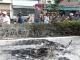 Xe máy chở 2 can xăng cháy ngùn ngụt trên đại lộ Phạm Văn Đồng