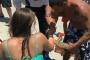Mỹ: Cô gái phải nhập viện cùng chú cá mập trên tay sau khi bị nó cắn không buông