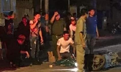 Cô gái lồm cồm bò dậy cạnh nam thanh niên bị xe container cán chết