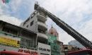 Giải cứu 3 người mắc kẹt trong đám cháy tòa nhà 5 tầng ở TPHCM
