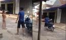 Clip 'bố bắt con trai cởi quần áo đứng hát giữa đường' gây tranh cãi