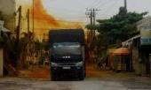 binh-duong-xu-ly-an-toan-thung-axit-1000-lit-tran-do-tren-duong-326902.html
