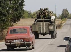 Rạng sáng, đạn pháo vẫn rung chuyển miền đông Ukraine