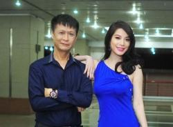 Trương Ngọc Ánh nổi bật với đầm xanh biếc bên đạo diễn Lê Hoàng