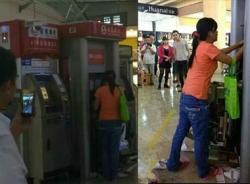 TQ: Bị máy nuốt thẻ, người phụ nữ đập nát cả cây ATM