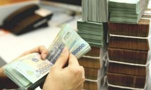 Lãi suất tiền gửi dưới 6 tháng giảm về 4%/năm