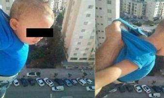 Chỉ vì 1.000 like trên Facebook, người cha thản nhiên túm áo rồi nhấc con lơ lửng từ cửa sổ tầng 15