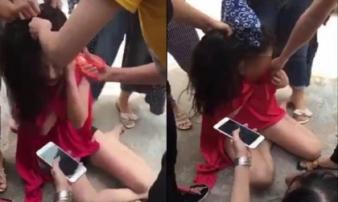 Hotgirl bị cắt tóc, xé quần áo, bắt đọc mật khẩu điện thoại vì nghi cặp bồ với đại gia