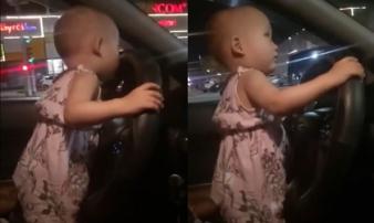 Truy tìm lái xe cho bé gái cầm vô lăng lái xe đi chơi Trung thu