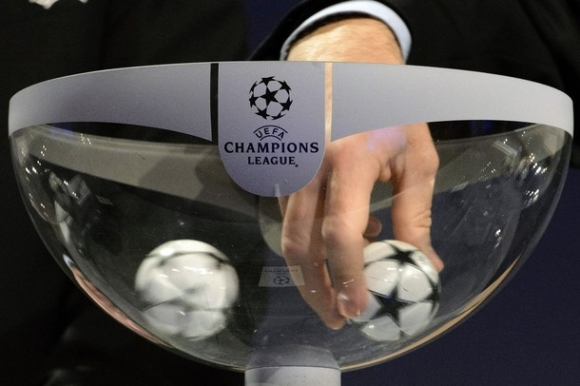 UEFA General Secretary Gianni Infantino draws a ball  during the draw of the games of the third qualifying round of the UEFA Champions League 2012/13 at the UEFA Headquarters in Nyon, Switzerland, Friday, July 20, 2012.