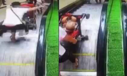 Mẹ đánh rơi con nhỏ lăn xuống thang cuốn