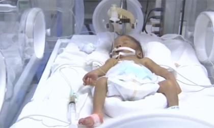 Thiếu úy từ chối điều trị ung thư để cứu con: Cháu bé hồi sinh thần kỳ