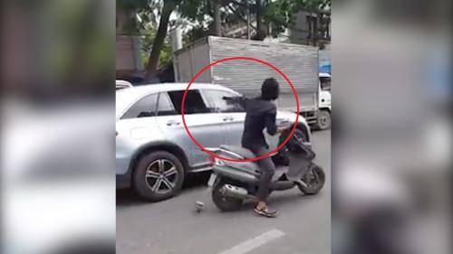 Kẻ điên cuồng chặt kính ôtô ở Sài Gòn bị xử lý thế nào? - 1