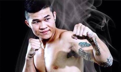 """Nhà vô địch boxing lý giải việc """"chấp 2 chân"""" để tỉ thí với Flores"""