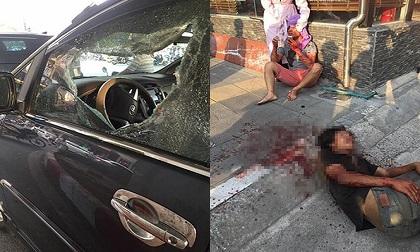 Lái xe ô tô bị đối tượng lạ phá cửa kính, hành hung