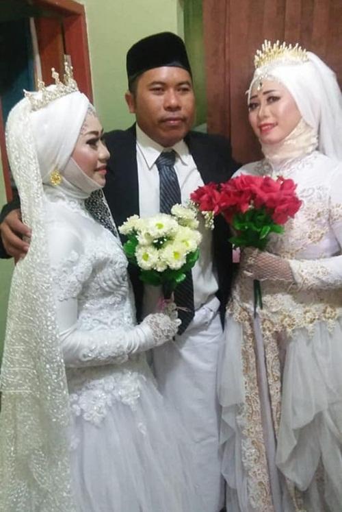 Đám cưới gây sốc khi có một chú rể, hai cô dâu - 1