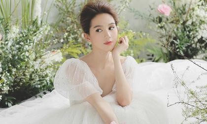 Sau chia sẻ muốn có con, Ngọc Trinh tung bộ ảnh mặc váy cưới đẹp đến nao lòng