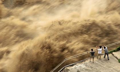 Nguyên nhân nào gây ra tình trạng lũ lụt ảnh hưởng tới hàng chục triệu người ở Trung Quốc?