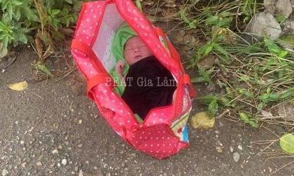 Bé trai sơ sinh nằm trong túi xách bị bỏ rơi ven đường ở Hà Nội