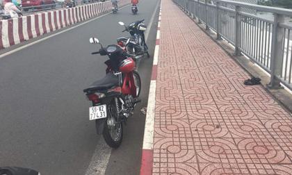 Để lại xe máy trên cầu, người phụ nữ bất ngờ nhảy xuống sông Sài Gòn tự tử