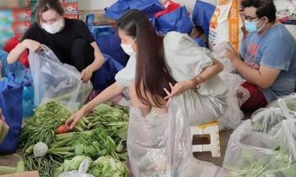 Thủy Tiên và Công Vinh tự tay chia rau củ gửi cho 5.000 người nghèo ở Sài Gòn