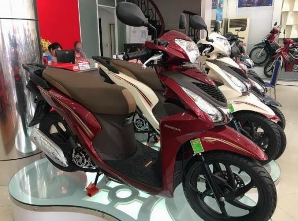 Honda SH tiếp tục giảm giá, SH Mode và Vision bay tiền triệu - Ảnh 2.