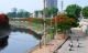 Ảnh Sông Tô Lịch đẹp lạ mùa phượng vĩ nở hoa