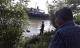 Thi thể nam thanh niên mặc áo cầu thủ nổi trên sông Lam