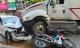 TP.HCM: Kinh hoàng container lao qua dải phân cách, tông nát xe BMW và cuốn nhiều xe máy vào gầm